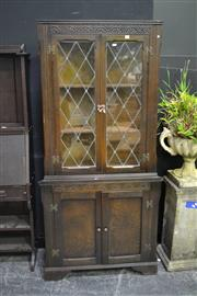 Sale 8039 - Lot 1011 - 1930s Carved Oak Corner Cabinet, with two leadlight doors and two panel doors
