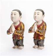 Sale 8844 - Lot 4 - A pair of polychrome timber oriental praying figures of boys. Height 32cm (crack to one)