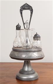 Sale 8868H - Lot 96 - A silver plated five bottle cruet stand with handle, Height 45cm