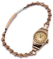 Sale 9090J - Lot 366 - A VINTAGE 9CT GOLD LADYS WRISTWATCH; round dial Arabic numerals, 15 jewel Swiss movement, cal. 8/390 marks for Empress, case size 2...