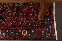 Sale 9160H - Lot 39 - A Persian woollen Herati carpet with geometric floral pattern on red and blue ground, Length 360 x Width 148cm