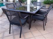 Sale 8562A - Lot 244 - A seven piece rattan effect outdoor suite comprising a rectangular glass top table, H 74 x L 180 x D 100cm, and six armchairs with c...