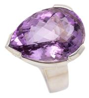 Sale 9074 - Lot 331 - A STERLING SILVER AMETHYST COCKTAIL RING; set with a chequerboard pear cut amethyst of approx. 22ct, size P, top 24 x 17mm, wt. 13.65g.