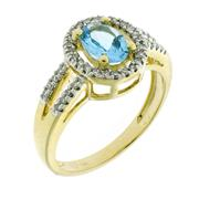Sale 8534J - Lot 303 - A 14CT GOLD GEMSET CLUSTER RING; centring on an oval cut blue topaz, to shoulders and surround set with single cut diamonds totallin...