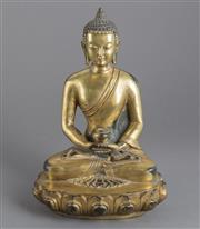 Sale 8536 - Lot 68 - Gilded bronze Buddha, Tibetan China, 18th century style, seated cross-legged in the dhyanasana pose holding an offertory vessel, mar...