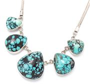 Sale 9066 - Lot 325 - A SILVER TURQUOISE NECKLACE; centring 5 rub set graduated pear shape cabochon turquoise 27 x 25 - 16 x 15mm on a foxtail chain with...