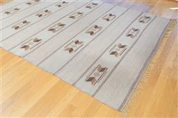 Sale 9165H - Lot 25 - A woven carpet with repeating arrow head motif 290x197cm