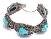 Sale 9010H - Lot 97 - A Chinese silver and treated turquoise bracelet with an intricate filigree design
