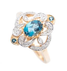 Sale 9253J - Lot 371 - A 9CT GOLD NOUVEAU STYLE TOPAZ AND DIAMOND RING; claw set in the center with an oval cut London blue topaz to scrolling pierced surr...