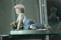 Sale 7907 - Lot 80 - Lladro All Aboard Figure of a Boy with Train