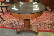 Sale 8255 - Lot 1045 - Early 19th Century French Mahogany Occasional Table, with revolving black marble top fitted with a drawer, a loose double sided cove...