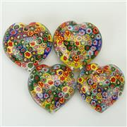 Sale 8399 - Lot 94 - Murano Millefiori Set of Four Heart Shaped Paperweights
