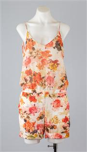 Sale 8685F - Lot 30 - A Zara floral print polyester play suit with dropped waist, size EU XS