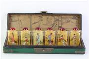 Sale 8806 - Lot 84 - A Chinese Green Lacquered Box With Inside Painted Glass Snuff Bottles
