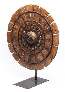 Sale 9123J - Lot 265 - An antique Indonesian spinning wheel or Charkha mounted on a cast iron frame, height 70cm
