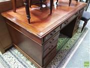 Sale 8428 - Lot 1037 - Victorian Walnut Double Pedestal Desk, with tooled leather writing surface and fitted with nine drawers