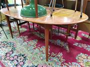 Sale 8566 - Lot 1155 - Oval Parker Dining table (105 x 180)