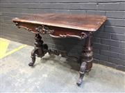 Sale 9014 - Lot 1078 - Early Victorian Rosewood Side Table, with bold scroll carved apron, turned end supports & conforming stretcher & legs (some scratche...