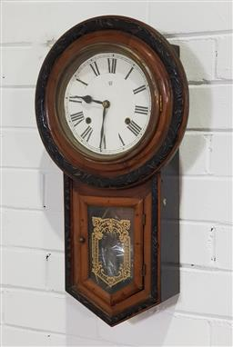 Sale 9215 - Lot 1051 - Late 19th Century Waterbury Drop-Case Wall Clock, with two train movement, round white dial & glazed waist door with stencilled desi...