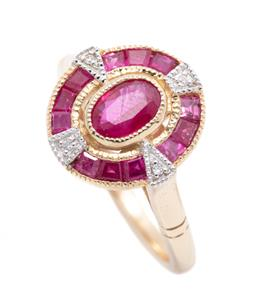 Sale 9253J - Lot 467 - A 9CT GOLD DECO STYLE RUBY AND DIAMOND RING; target cluster centring an oval cut ruby to halo of mixed cut treated rubies and 4 roun...