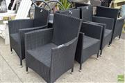 Sale 8532 - Lot 1218 - Set of Eight Modern Poly-Wicker Outdoor Armchairs