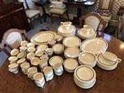 Sale 8815A - Lot 54 - A large quantity of cream and gilt dinner wares made up of three sets including Crown Ducal and Burleighware