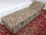 Sale 9023H - Lot 75 - A zebra print day bed with storage compartment and white cotton removable covers, with raised chrome legs , total length 2m W-64cm H...