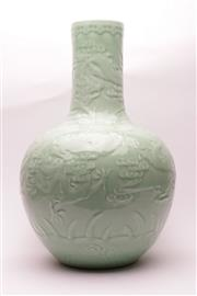 Sale 9023 - Lot 75 - A large celadon glazed Chinese vase featuring dragon H: 62cm
