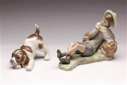 Sale 9107 - Lot 2 - Lladro figure of a dog (L13.5cm) together with a Lladro boy figural group (L21cm) - chip to foot of boy
