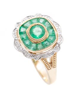 Sale 9253J - Lot 388 - A 9CT GOLD DECO INSPIRED EMERALD AND DIAMOND RING; centring a round cut emerald surrounded by 12 mixed cut emeralds and scalloped bo...