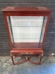 Sale 8976 - Lot 1003 - French Style Vitrine or Display Cabinet, with brass mounts, the upper glazed section with sliding front door, raised on turned legs...