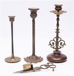 Sale 9185E - Lot 45 - A group of three brass candle holders together with a snuffer, tallest Height 24.5cm