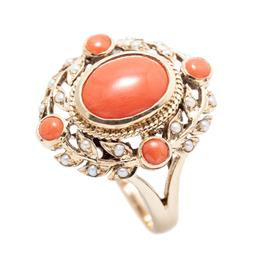 Sale 9253J - Lot 358 - AN EDWARDIAN STYLE 9CT GOLD CORAL AND PEARL RING; centring an oval cabochon coral to laurel surround set with seed pearls and 4 roun...