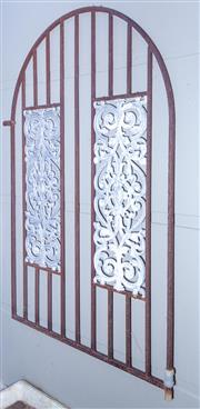 Sale 8568A - Lot 188 - An arched wrought iron door with cast metal panels, H 157 x W 105cm