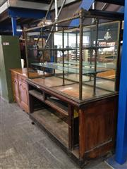 Sale 8760 - Lot 1013 - Art Deco Brass & Timber Department Store Display Case, the upper case with guilloche type frames and with flourishes, the lower sect...