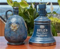 Sale 9099 - Lot 274 - A Royal Doulton jug, height 20cm, together with a Wade ceramic Bells Whisky decanter, Height 21cm