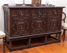Sale 9190H - Lot 139 - A large Jacobean style oak carved sideboard with three doors and three doors raised on stretcher base, Height 109cm x Width 166cm x...
