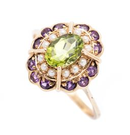 Sale 9253J - Lot 354 - A 9CT GOLD GEM SET CLUSTER RING; centring an oval cut peridot to seed pearl surround and scalloped border of 12 round cut amethyst,...
