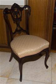 Sale 7981B - Lot 22 - An Edwardian Mahogany shaped back occasional chair with a carved centre swag within a shield on