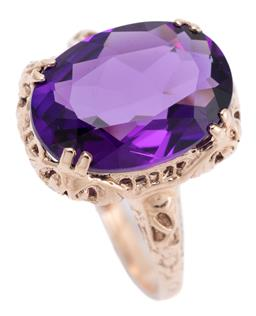 Sale 9253J - Lot 456 - A 9CT ROSE GOLD EDWARDIAN STYLE AMETHYST RING; split claw set with a fine oval cut amethyst of approx. 5ct on a pierced gallery, top...