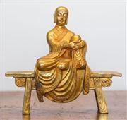 Sale 8284A - Lot 64 - A Chinese carved bronze monk, sitting on a bench, h32cm