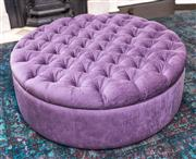 Sale 8298 - Lot 27 - A Large Circular purple button cushioned ottoman with pillow top.