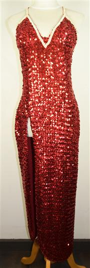 Sale 8460F - Lot 8 - A vintage red sequined cabaret dress with cross back straps and large split to right front, size S