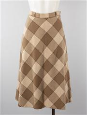 Sale 8740F - Lot 153 - A vintage Sportscraft A-line skirt in a checkered wool-blend, size 12
