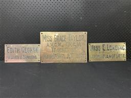 Sale 9117 - Lot 1047 - Collection of 3 pressed brass PIANOFORTE teacher signs (h:28 x w:38cm)