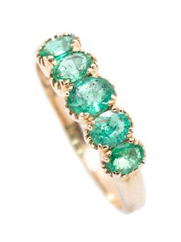 Sale 9253J - Lot 360 - A 9CT GOLD EMERALD RING; set across the top with 5 graduated oval cut emeralds, width 6mm, size O, wt.2.35g.