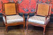 Sale 8222 - Lot 65 - A set of four javi lounge chairs with cane back, upholstered in Catherine Martin upholstery Film Provenance; Australia, 2008, one A/F