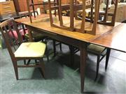 Sale 8643 - Lot 1147 - Younger Afromosia Teak Table and Set of 6 Chairs