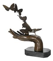 Sale 9034A - Lot 5040 - Hand and Butterflies, bronze sculpture on marble base after Milo, H 30 cm