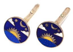Sale 9186 - Lot 377 - A PAIR OF CLOISONNE SILVER GILT CUFFLINKS; 17mm wide discs enamelled in blue white and yellow with the setting sun moon clouds and s...